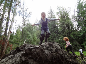Photo: The children enjoyed playing on the pile of topsoil, that was later spread in the completed wetland.