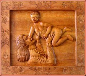 Madre e hijo. Talla en madera.