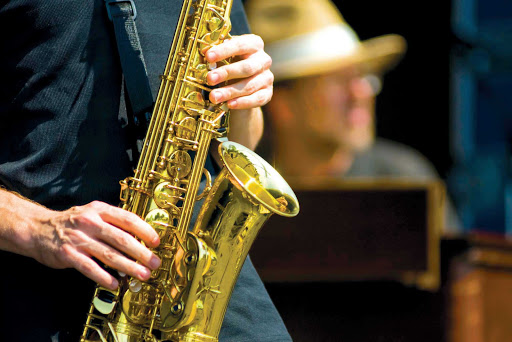 Sax-Player-Closeup.jpg - Enjoy classic melodies from bar and street performers in New Orleans during your sailing on American Cruise Lines.