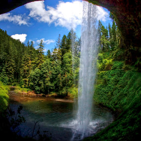 Waterfall from the cave by Chip Bolcik - Landscapes Caves & Formations