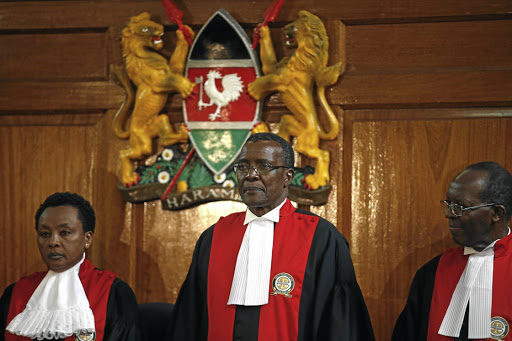 Kenyan Supreme Court chief justice David Maraga, centre, shortly before he delivered a ruling that declared invalid the August presidential election, in Nairobi on September 1 2017. Picture: REUTERS