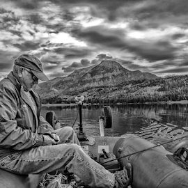 Tying the lure by Joe Saladino - Black & White Portraits & People ( fishing, monochrome, black and white, man, clouds, water, lake, boat )