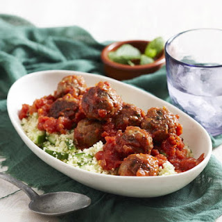 Lamb and Apricot Meatballs with Couscous and Tomato Sauce.