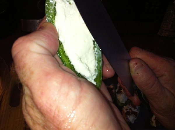 Fill jalapeno halves with cream cheese