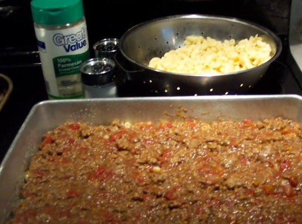 """Heat oven to 350F. Grease a 9"""" square baking pan. Place 1/2 of macoroni into baking..."""