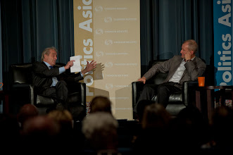 """Photo: Sir Harold Evans asks Admiral Dennis Blair a question during the """"Threats and Opportunities"""" discussion Thursday, Nov. 15, 2012 at the RAND Politics Aside event in Culver City."""