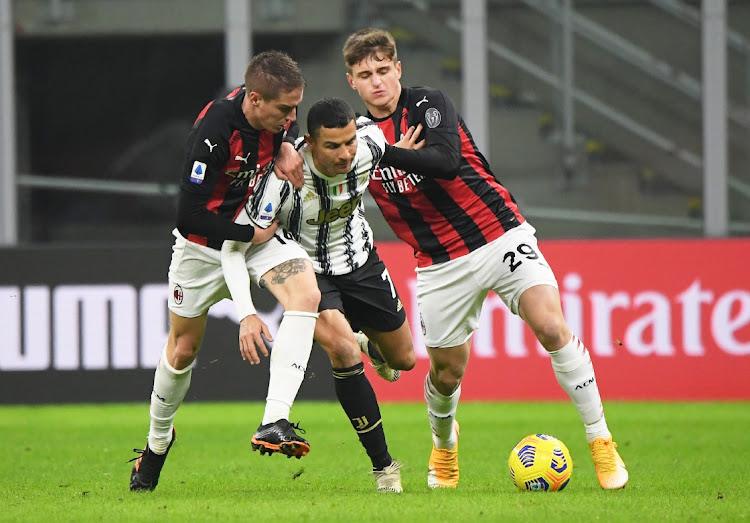 Juventus' Cristiano Ronaldo in action with AC Milan's Lorenzo Colombo. File photo: REUTERS/ALBERTO LINGRIA