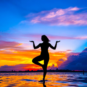Sky On Fire by Kyle Re - Landscapes Sunsets & Sunrises ( calm, water, clouds, peaceful, colorful, waves, silhouette, balance, figure, sky, serene, ripples, sunset, woman,  )