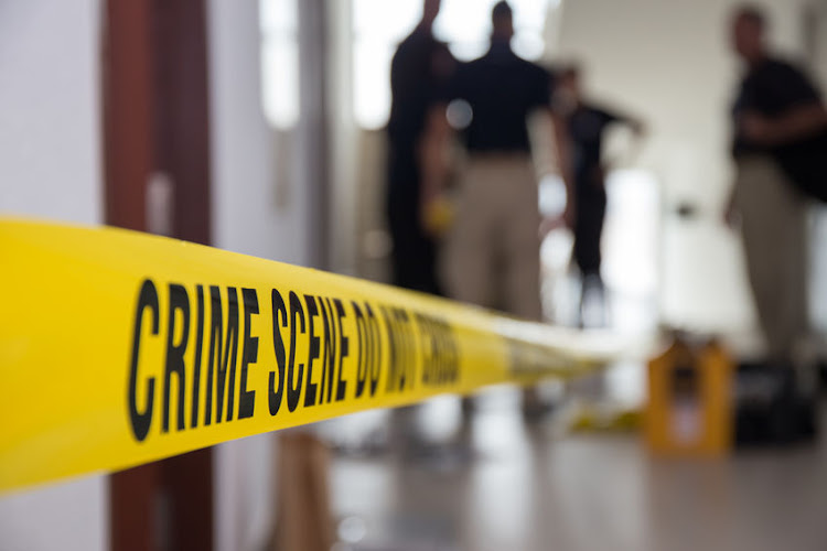 Police found the two badly assaulted bodies in a room wrapped in plastic.