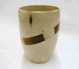 "Photo: Donald Van Ryk - uniquely segmented vase of maple, walnut, cherry, and sycamore, 5""x8"""