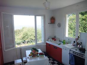Photo: Bright ocean-view Kitchen