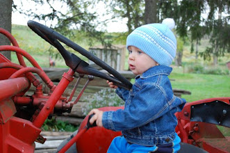Photo: Wes loves driving the tractor.