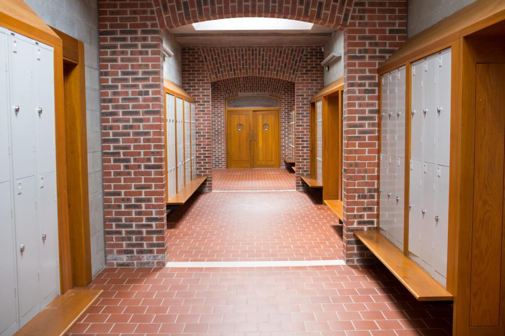 http://streaming.yayimages.com/images/photographer/wavebreakmedia/04c1a33db29ff4453311641c5b5e89e8/brick-walled-corridor-with-tiled-flooring-in-college.jpg