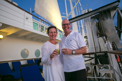 Leonie and David, two guests from Sydney, on Wind Surf as the mast lights up at twilight.