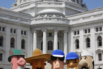 Photo: the milwaukee brewers' sausages visit the state capital in madison. no racing involved.