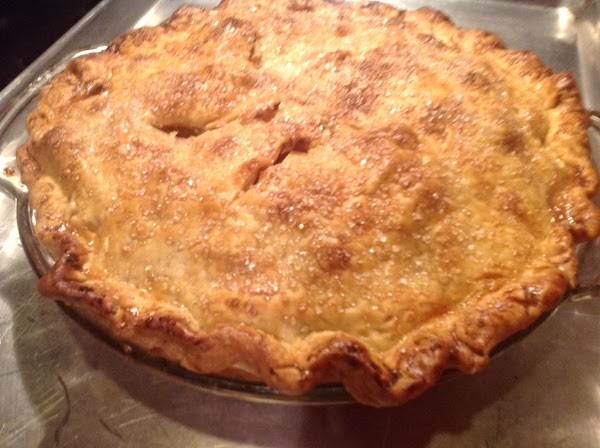 Place pie plate on a shallow baking sheet to catch any potential drips during...