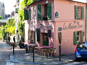 """Photo: Once painted by Utrillo, La Maison Rose (the Pink House) is a charming little restaurant, and has less of the """"tourist conveyor-belt"""" feel to it, and is a lot less crowded, than the restaurants further up the hill."""
