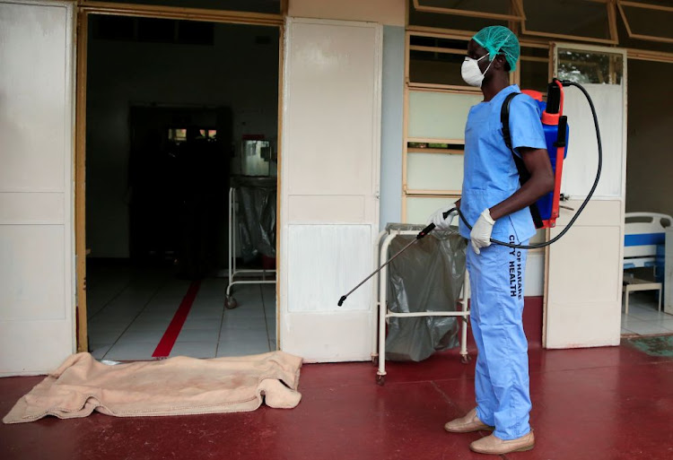 A health worker wears a protective suit during a demonstration of preparations for any coronavirus cases at a hospital in Harare, Zimbabwe, on March 5 2020. Zimbabwe on Monday announced its first Covid-19 related death.
