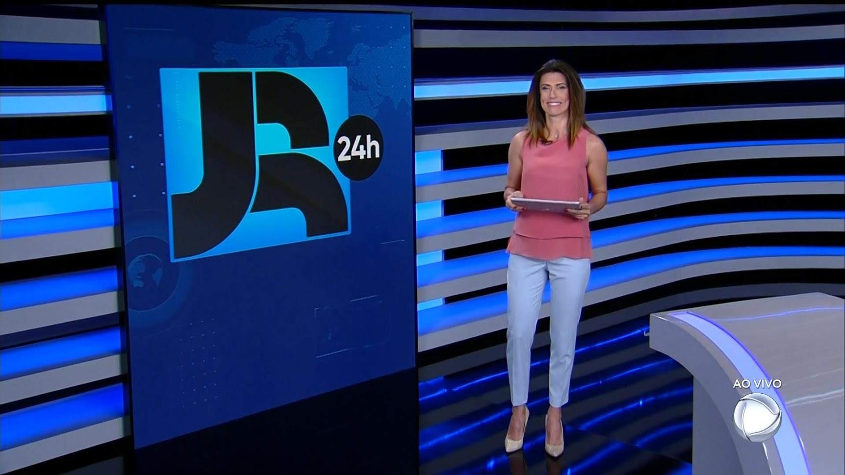 Janine Borba apresentando o JR 24h