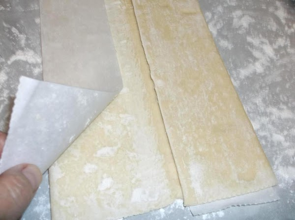 Place thawed puff pastry dough on paper; carefully unfold dough; repair any cracks by...
