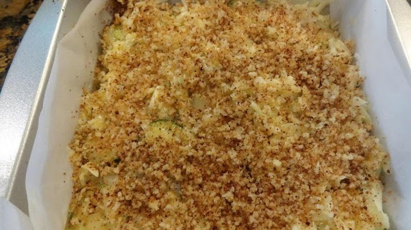 Top with the fresh bread crumbs and drizzle with the melted butter.