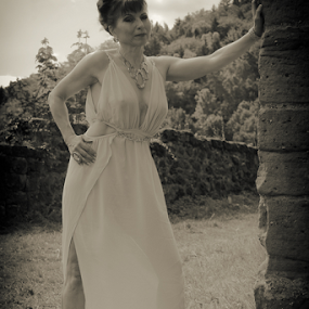 by Johannes Oehl - Black & White Portraits & People ( muscular, romance, romanesque, dress, castle, female hairstyle, 12th century, fashion-photography, apparel, rheinland-pfalz, lower arm, upper-arm, building, looking at camera, hip, frankenstein castle, leg, beautiful, one female adult only, up do, palatinate forest-north vosges biosphere reserve, rhineland-palatinate, full body, place of interest, medieval architecture, black and white, wardrobe, female, costume, ruin, brickwork, pfalz, old, tree, july, monochromatic, german ethnicity, history, ancient, 11 brown iris, thin, spur castle, red sandstone, idyllic, person, outside, leaning, waist, stone wall, forest, underarm, brick wall, germany, palatinate, martin-schultz scale, sandstone, summer, 55-60 years, arm outstretched, romantic, unesco, brunette, lower leg, brick, europe, arm, architecture, frankenstein, 1 person, brunet, historic, middle ages, nature, sexy, biosphere reserve, medieval, people-photography, brown eyes, necklace, brown hair, clothes, dark mixed eyes, hill, standing, outdoors, monochrome, fair skin, fashion )