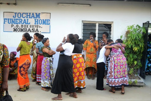 Friends and relatives of Ansila Charo, one of two domestic workers who died in Saudi Arabia, mourn after viewing her body at Jocham funeral home, Mombasa