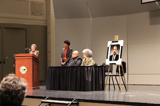Photo: The Honorable Vel Phillips at the podium. Dr. Anika Wilson, Dr. Karenga and his wife on stage. Prof. Van Horne's portrait has been unveiled.