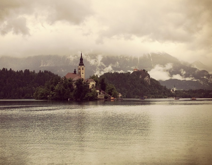 Bled on a rainy day by Aleš Krivec - Instagram & Mobile iPhone ( stormy, clouds, water, building, mountain, gothic, church, waterscape, drop, lake, storm, island, snow, bled, cloud, castle, cathedral, rain )