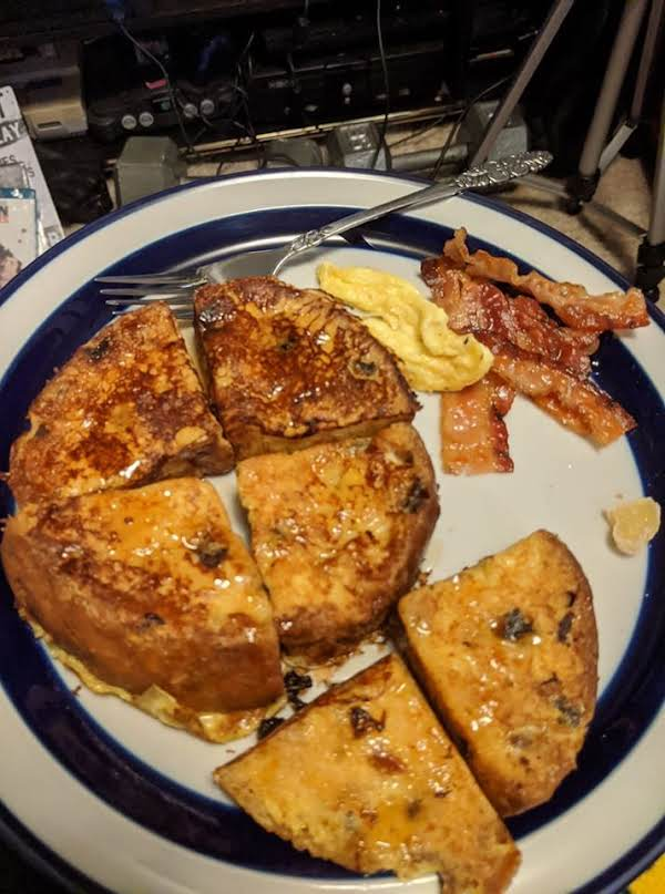 A Plate Of Panettone Italian Toast, Bacon, Egg And Candied Ginger.