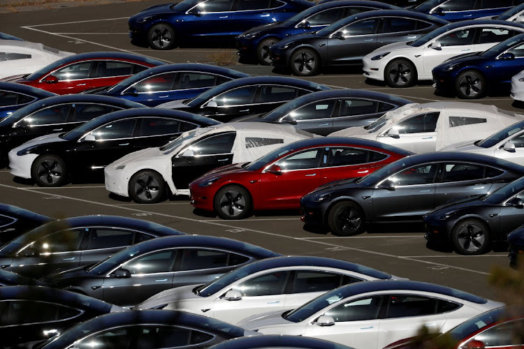 Tesla Model 3 electric vehicles are lined up in a lot in Richmond, California. Picture: REUTERS/STEPHEN LAM