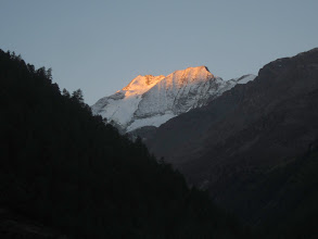 Photo: Dawn lights the Weisshorn as we gear up to cross the last pass of our trip--the Augstbord.