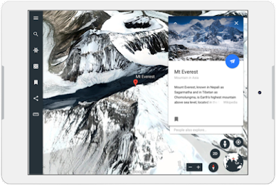 A tablet showing an overhead view of snowy mountains from Google Earth.