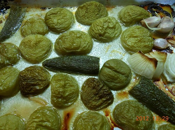 MAKE AHEAD SAUCE:Remove husks from tomatillos and cut in half.  Remove stems from...