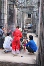 Photo: locals praying to Buddha at Angkor Thom temple