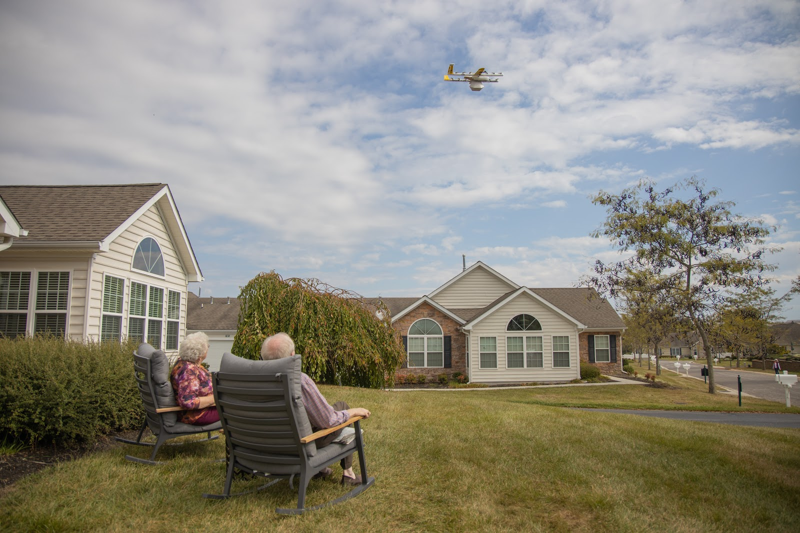 Customers receiving Wing package via drone delivery