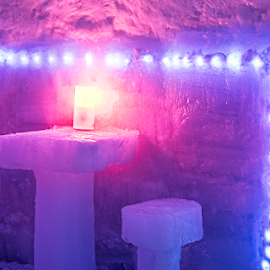 a table with two chairs and a light made of ice by Roberto Sorin - Buildings & Architecture Other Interior ( mountains, tourism, winter, cold, ice, ice skating, romania, carpathians, holiday, building, beautiful, mountain, white, beverage, chairs, hotel, vacation, resort, glacier, leisure, table, architecture, glacial, editorial, sky, glass, famous, led light, transylvania, nature, relaxation, restaurant, statue, sculpture, panorama, blue, light, background, snow, alpine, balea, travel, sibiu, jager, party,  )