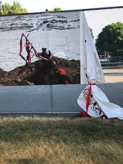 <p> July 12. Red ribbon has been untied in an attempt to remove it? Perhaps by the same person that tried to remove some of the graffiti? Perhaps mistaking the ribbon for an act of vandalism?</p>