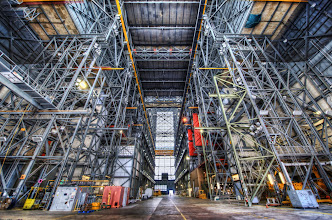 Photo: The Megahangar at NASA  The VAB, or Vehicle Assembly Building, is the worlds largest single-story building, and it's where NASA assembles many of the rockets, including the mighty Saturn V.  It's also the tallest building in the US that's not in a downtown area.   It's situated at Launch Complex 39 at the Kennedy Space Center, and it's awesome dot com.  The thing is so big that it even has its own weather system.  In fact, on humid days it can even rain inside the building!  In my photo below, you are really only seeing part of it.  Off to the right, they are fueling up the Atlantis for its upcoming mission.  Staring through the girders from another angle, you can easily see the giant orange tank going through its pre-launch ordeal.  from Trey Ratcliff at www.stuckincustoms.com