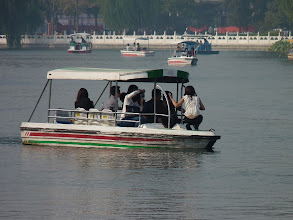 Photo: Beijing - Houhai lake with boats and Chinese taking photos everywhere