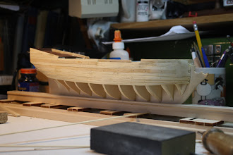 Photo: First plaking in process - shaping planks at bow is tricky