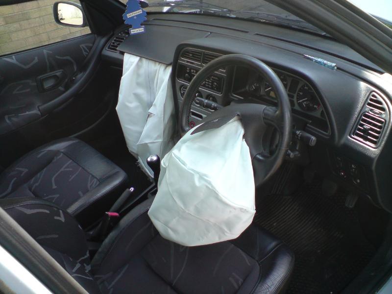 File:Peugeot 306 airbags deployed.jpg