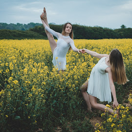 I've got you by Vix Paine - Babies & Children Child Portraits ( beauty, dancers, pose, rapeseed field, dance photography, child dancer, dance move, yellow, ballet, sisters, bare feet, teenagers, flower, dancer, working together, colour, rapeseed, family, sister, child, teenager )