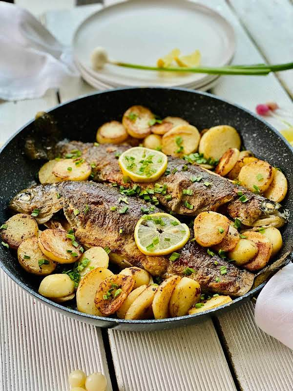 This Pan-cooked Rainbow Trout With Potatoes And Spring Garlic Makes An Amazing Family Friday Or Any Day Meal. It Is Packed With Nutritious Goodness. And These Potatoes… Mmmm!