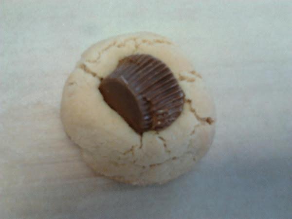 Peanut Butter Thumbprints W/pb Cup Atop Recipe