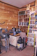 Photo: Lathe corner. Lots of turning blanks, magazines, and books...