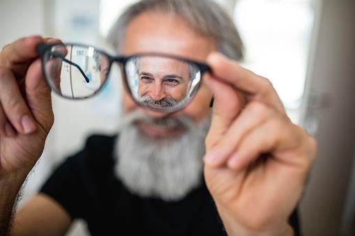 https://media.istockphoto.com/photos/mature-man-testing-out-new-glasses-picture-id1155975995?b=1&k=6&m=1155975995&s=170667a&w=0&h=0s0d8sWmATRq8oef7sAjPBTDf2ajlJrbZkyy5tnI_XY=