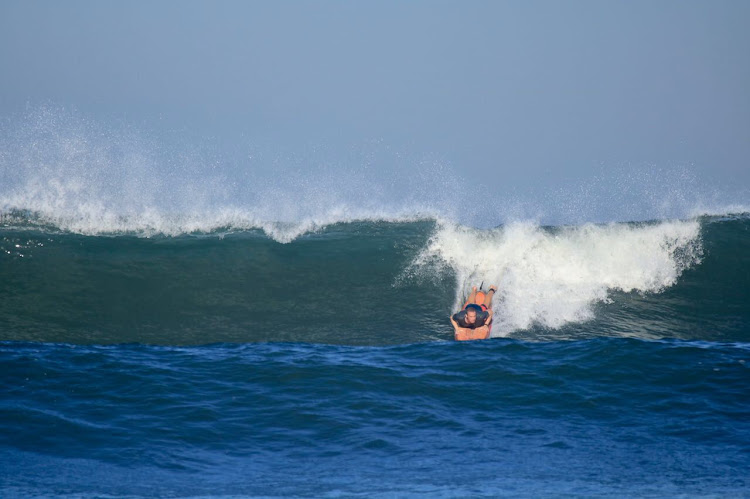 The writer learning to surf in Indonesia. Picture: LUKE GELDENHUYS
