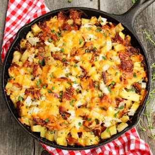 Cheesy Grilled Skillet Potatoes with Bacon and Herbs