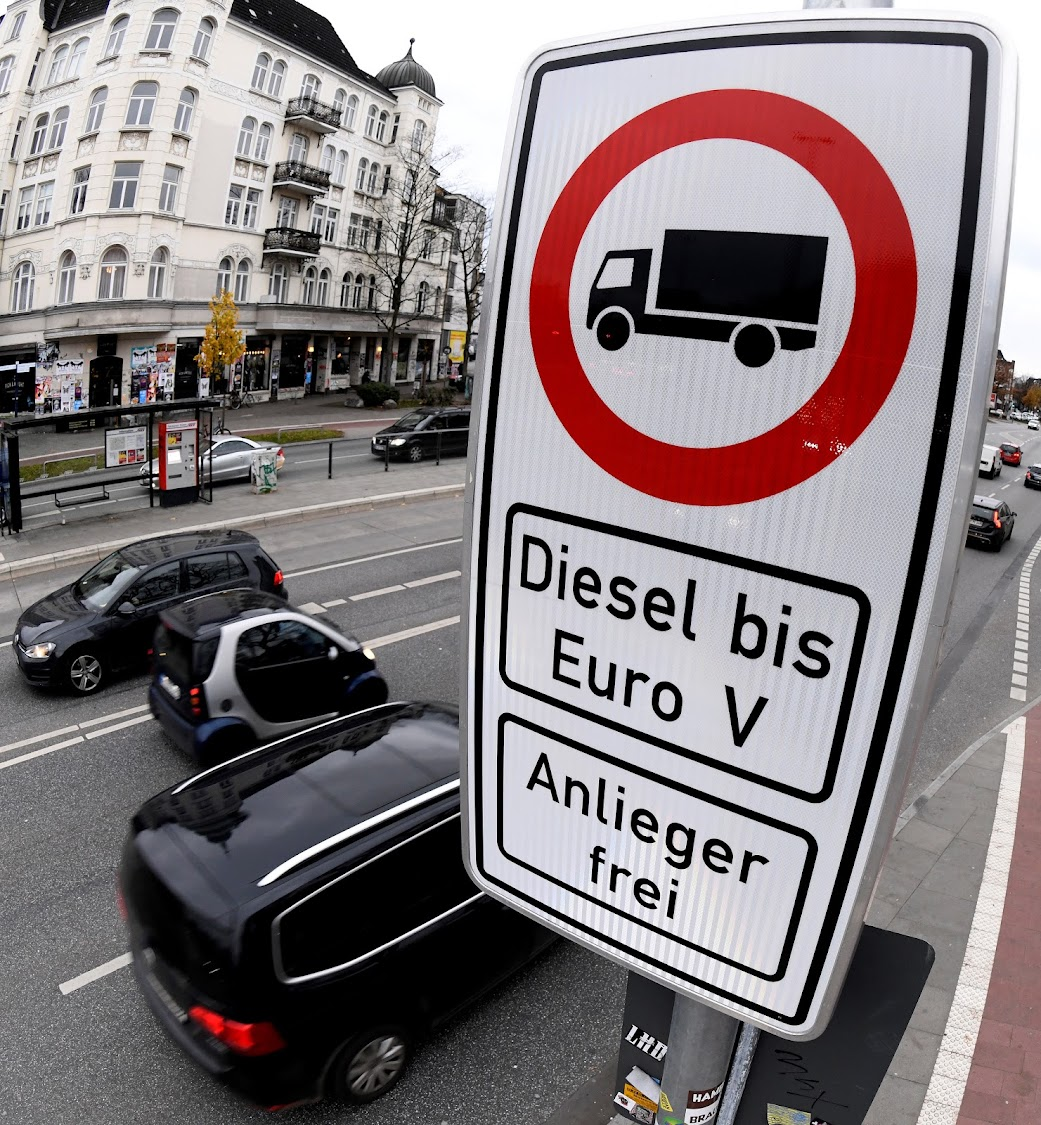 Cars pass a traffic sign banning diesel cars on a street in downtown Hamburg, Germany. Picture: SUPPLIED